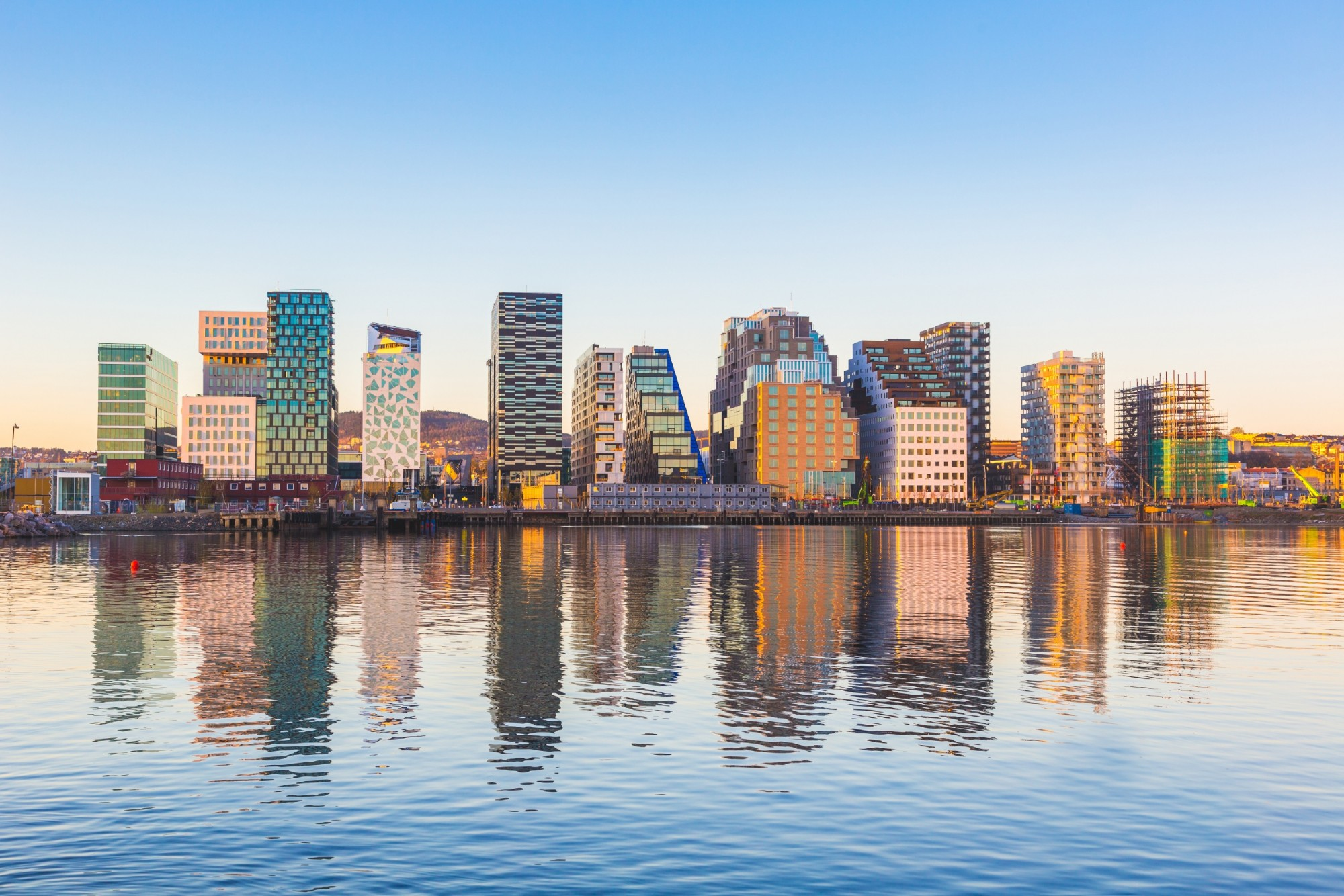 Modern buildings in Oslo, Norway, with their reflection into the water.
